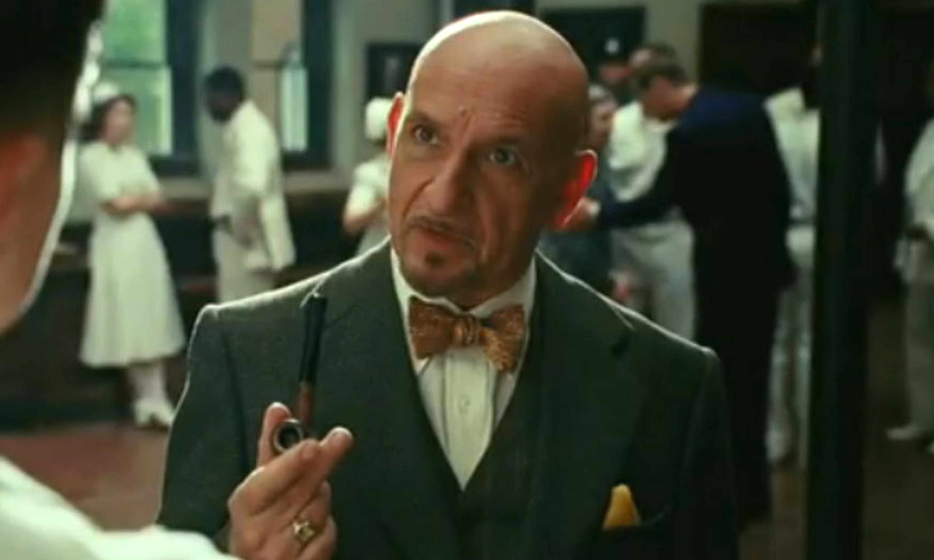 Ben Kingsley smoking a cigarette (or weed)